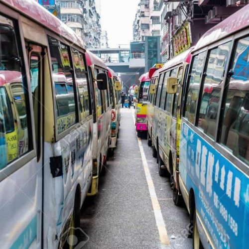 Hong Kong, Hong Kong - March 10, 2017: station with public light buses and unidentified people. The public light bus is a transport service in HK. The minibuses serve other bus lines cannot reach